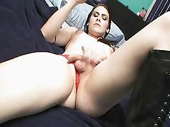Sexy brunette trannie in boots plays with her hard cock