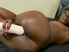 Ebony Babe Using Her Toy Collection on That Shaved Pussy
