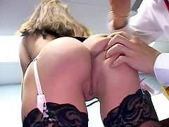 Reality sex with an office attendant in stockings being nailed from behind