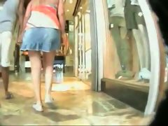 Voyeur upskirt vid of a fat blonde chick shopping with her husband