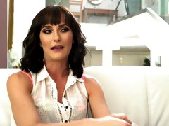 Gorgeous milf Bianca Breeze gives an interview before shooting