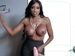Ebony pussy rides on top of a white cock