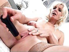 Naked old lady in stockings fucks her dildo
