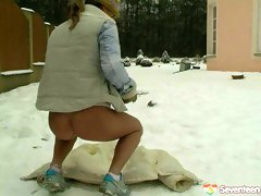 Spoiled brunette MILF drills her bald cunt with dildo in snow