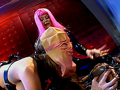 A lesbian mistress does some wild, kinky things with her slave