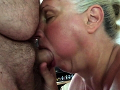 Naughty blonde granny kneels down and gives a hot blowjob
