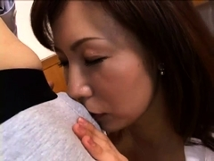 Busty Asian mom has a young guy licking and fucking her cunt