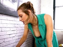 Nice secretary Jayne shows off her nice boobies with perky nipples