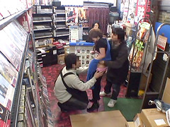 Two slim Japanese chicks get fucked doggystyle in a shop