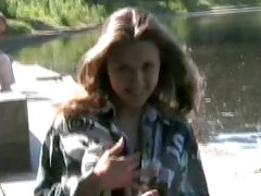 Fantastic lusty young babe shows off her big breasts and sexy ass by the lake