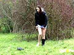 Filthy dark haired sex doll feels incredibly good pissing on green grass