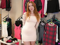 Nicely packed redhead Scarlett Jones is ready to expose her boobs