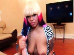 Tattooed ebony babe wanking hard dick in pov