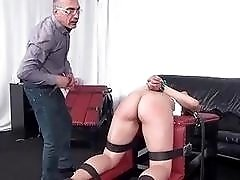 Tied up bitch gets whipped and dominated by BDSM dudes