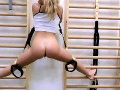 Fit blonde tries working the cock at the gym