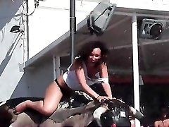 Sluts ride mechanical bull and flash in public