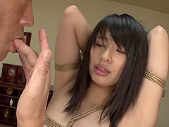 Tying up a hot and busty Japanese babe before getting blown