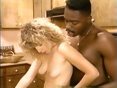 Naughty blonde bimbo in the kitchen bends over for black man