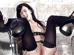 Dominant couple punish their mature slave's feet in BDSM dungeon