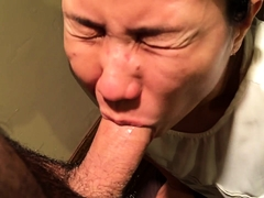 Slutty Oriental wife takes every inch of cock in her mouth