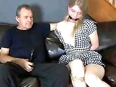 Freak gets his strapon sucked off by bondage whore BDSM