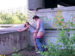 Slutty girl sucks two dicks outdoors and gets fucked from behind