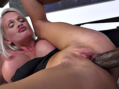 Blonde slut gets fucked doggy two rock hard black dicks