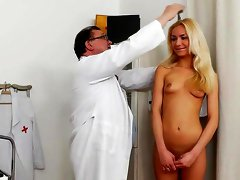 Blonde Victoria Puppy plays with her doctor