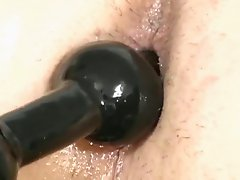 Hot close up of a horny gay taking sex balls up his ass hole