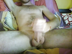 jerking big cock on bed