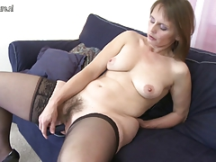 Hairy amateur mother playing with herself on the couch