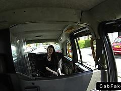 Dark haired babe in black dress banging in fake taxi